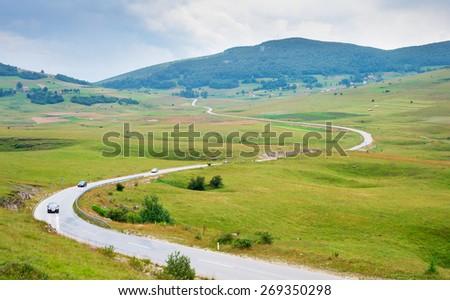 Country road in Bosnia and Herzegovinain the rainy day. - stock photo