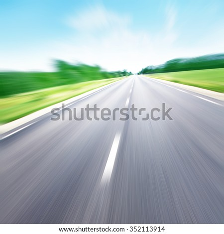 Country road in motion blur. - stock photo
