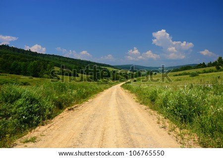 Country road in rural landscape of Beskid Niski Mountains, Poland