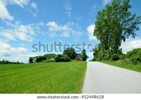 Country road in Vermont under a blue summer sky