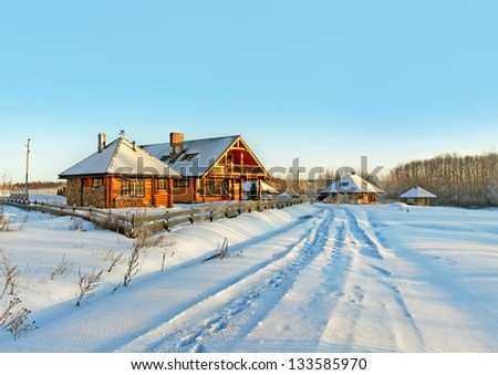 Country road is cover with snow in a winter season. - stock photo