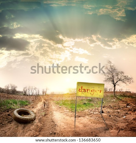 Country road leading into the restricted area - stock photo