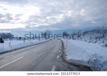 Country road through a snowy landscape