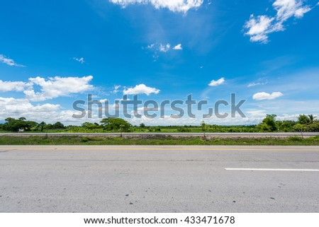 country road with blue sky in thailand - stock photo