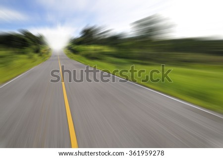 Country road with motion blur under blue sky