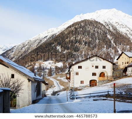 Country road with traditional houses in  Guarda,  Lower Engadine, Graubunden; Switzerland