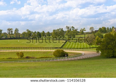 Country scenery with horse training track - stock photo