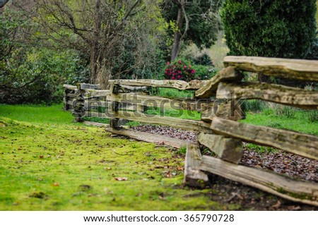 Country side field with old wooden fence - stock photo