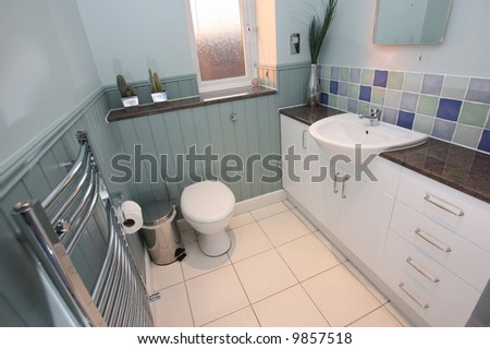 Country-style bathroom with wood paneling - stock photo