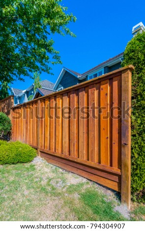 Country style wooden fence. Separate and protect private property.