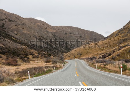Country village road with hills, Otago, Southland, New Zealand