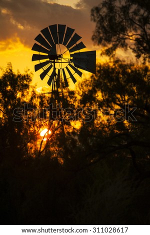 Country Windmill Silhouette with orange sky sunset