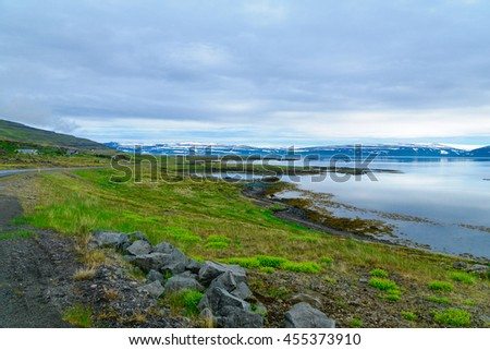 Countryside and landscape along the Mjoifjordur fjord, in the west fjords region, Iceland - stock photo