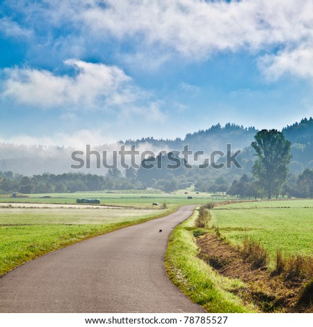 Countryside covered with fog in south germany - stock photo