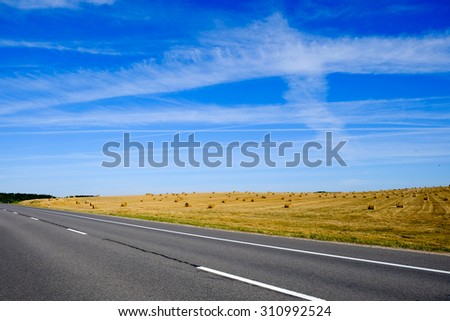 Countryside landscape and road - stock photo
