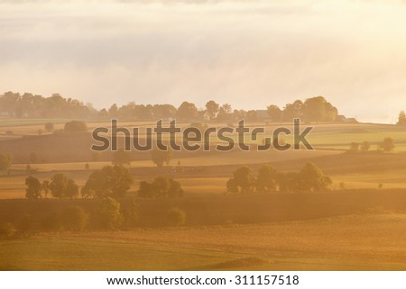 Countryside landscape in misty morning - stock photo