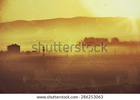 Countryside landscape in the morning fog. Filtered image, vintage effect applied
