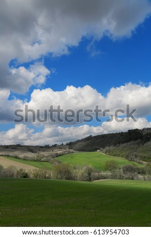Countryside landscape on a spring day, cloudy sky
