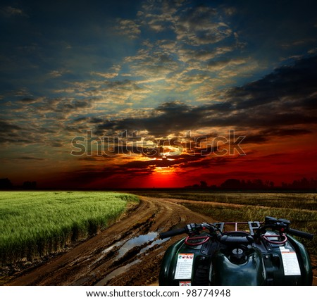Countryside landscape with dirt road after rain, Russia - stock photo