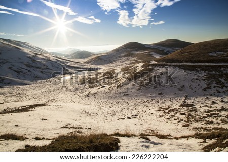 Countryside snowy mountains