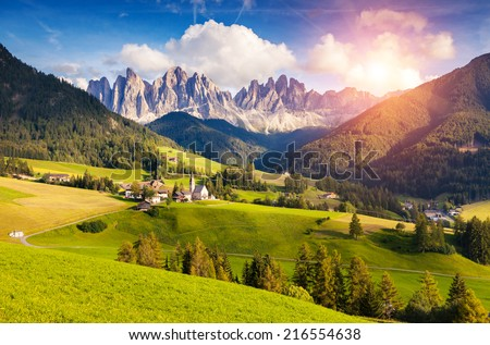 Countryside view of the St. Magdalena or Santa Maddalena in the National Park Puez Odle or Geisler summits. Dolomites, South Tyrol. Location Bolzano, Italy, Europe. Dramatic morning. Beauty world. - stock photo