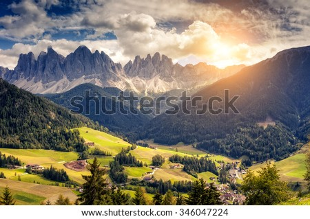 Countryside view of the valley St. Magdalena or Santa Maddalena in the National park Puez Odle or Geisler. Dolomites, South Tyrol. Location Bolzano, Italy, Europe. Dramatic unusual scene. Beauty world - stock photo