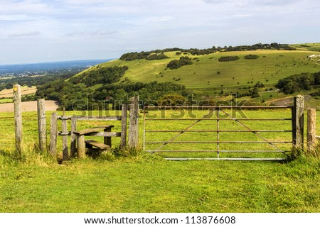countryside with gate - stock photo
