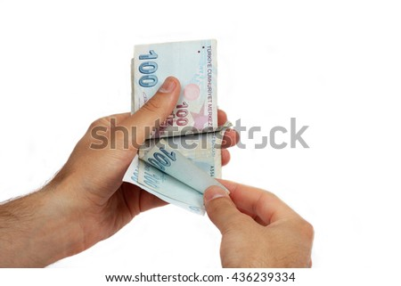 counts money in hands on white background