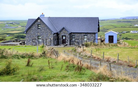 County Clare, Ireland - August 25, 2014: Rural farm houses among farmland.