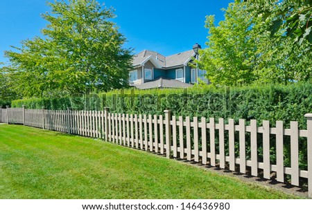 County style long wooden fence. - stock photo