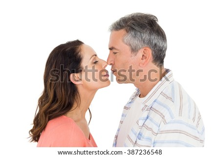 Couple about to kiss on white background