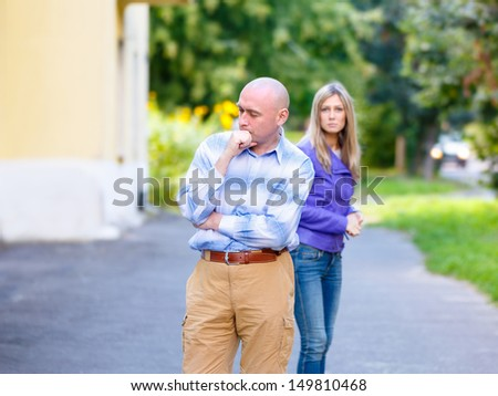 Couple after quarrel outside. Focus on men only - stock photo