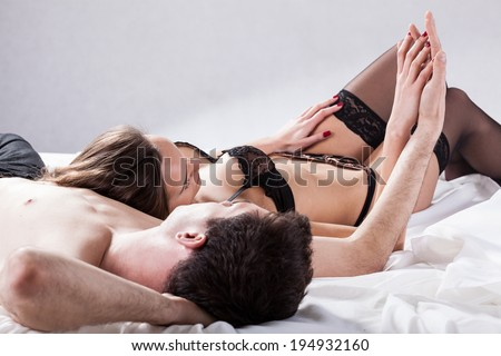 Couple after sexual moments in their bedroom - stock photo
