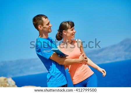 couple against a sky and sea - stock photo