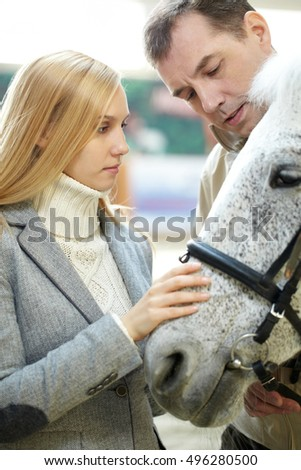 Couple and a horse