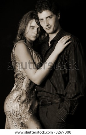 couple and hugging lovers over black background