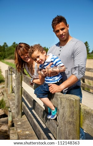 Couple and their little son enjoying time together on a sunny day