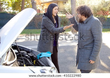 Couple angry at each other for accident with car - stock photo