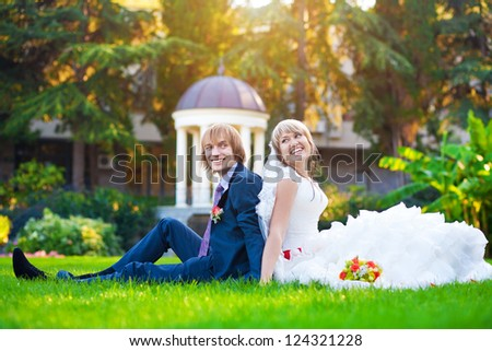 couple are sitting on the green grass
