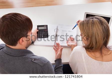 Couple argue about money especially house expenses. - stock photo