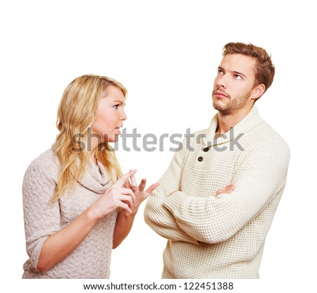 Couple argueing in over a problem with angry woman and sulking man - stock photo