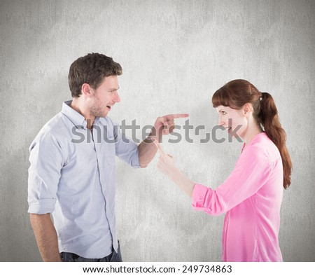 Couple arguing with each other against weathered surface