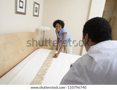 Couple arranging a bad - stock photo