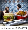 Couple at a diner to eat burger - stock photo