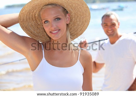 Couple at a lake in summer - stock photo