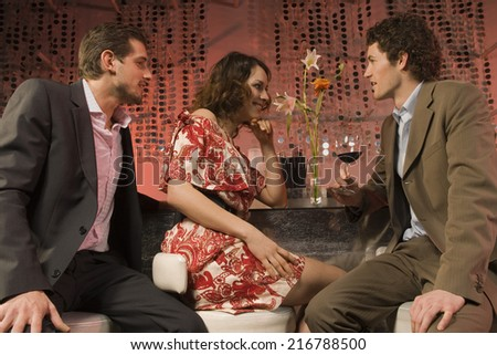 Couple at a nightclub. - stock photo