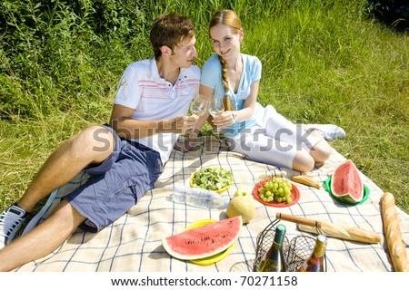 couple at a picnic - stock photo