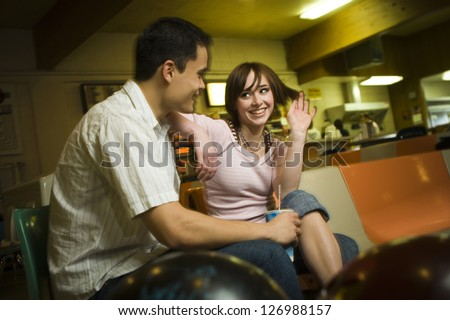 Couple at bowling alley
