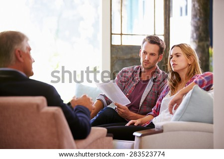 Couple At Home Meeting With Financial Advisor - stock photo