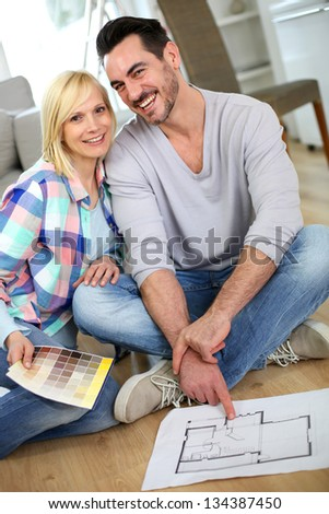 Couple at home ready to remodel the rooms - stock photo